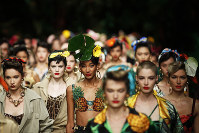 Models wear creations as part of the Dolce & Gabbana Spring-Summer 2020 collection, unveiled during the fashion week, in Milan, Italy, on Sept. 22, 2019. (AP Photo/Antonio Calanni)