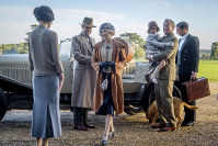 This image released by Focus Features shows Elizabeth McGovern, from left, Harry Hadden-Paton, Laura Carmichael, Hugh Bonneville and Michael Fox, right, in a scene from the film