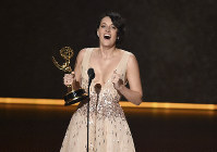 Phoebe Waller-Bridge accepts the award for outstanding writing for a comedy series for 'Fleabag' at the 71st Primetime Emmy Awards on Sept. 22, 2019, at the Microsoft Theater in Los Angeles. (Photo by Chris Pizzello/Invision/AP)