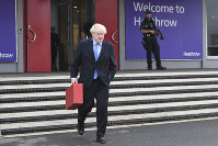 Britain's Prime Minister Boris Johnson walks to board his plane at London's Heathrow Airport as he heads off for the annual United Nations General Assembly in New York, on Sept. 22, 2019. (Stefan Rousseau/PA via AP)