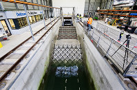 This photo taken in January 2019 and made available by Deltares shows the flume wave tank in Delft, Netherlands. (Guus Schoonewille/Deltares via AP)
