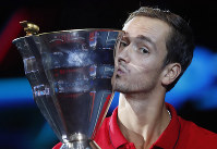 Daniil Medvedev of Russia kisses the trophy after winning the St. Petersburg Open ATP tennis tournament final match against Borna Coric of Croatia in St.Petersburg, Russia, on Sept. 22, 2019. (AP Photo/Elena Ignatyeva)
