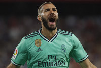 Real Madrid's Karim Benzema celebrates after scoring his side's opening goal during the Spanish La Liga soccer match between Sevilla and Real Madrid at the Ramon Sanchez Pizjuan stadium in Seville, Spain, on Sept. 22, 2019. (AP Photo/Miguel Morenatti)
