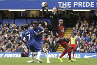 Liverpool goalkeeper Adrian grabs the ball during the British premier League soccer match between Chelsea and Liverpool, at the Stamford Bridge Stadium, London, on  Sept. 22, 2019. (AP Photo/Matt Dunham)