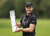 England's Danny Willett poses with the trophy after winning the PGA Championship at Wentworth Golf Club, Wentworth, England, on Sept. 22, 2019. (Bradley Collyer/PA via AP)