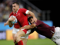 Wales Gareth Davies, left, is tackled by Georgia's David Kacharava during the Rugby World Cup Pool D game between Wales and Georgia at Toyota City Stadium, Toyota City, Japan, on Sept. 23, 2019. (AP Photo/Christophe Ena)