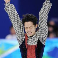 バンクーバー五輪、男子フリーの演技が終わり、ガッツポーズをする高橋大輔。銅メダルを獲得した=パシフィックコロシアムで2010年2月18日、須賀川理撮影