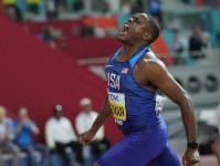 Christian Coleman, of the United States, celebrates winning the gold medal in men's 100 meter final at the World Athletics Championships in Doha, Qatar, on Sept. 28, 2019. (AP Photo/David J. Phillip)