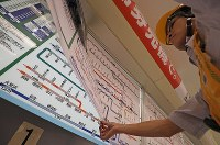 A worker updates a fare chart at JR Shinjuku Station in Tokyo after the last train in the early hours of Oct. 1, 2019, in accordance with the consumption tax hike from 8% to 10%. (Mainichi/Shinnosuke Kyan)
