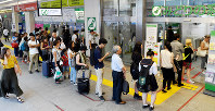 People form a long line in front of a ticket office at JR Shinjuku Station in Shinjuku Ward, Tokyo, on Sept. 30, 2019, to purchase their commuting passes before the consumption tax hike took effect the next day. (Mainichi/Daiki Takikawa)
