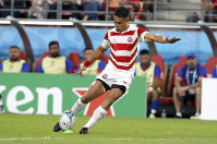 Japan's Yu Tamura kicks a penalty goal during the Rugby World Cup Pool A game at City of Toyota Stadium between Japan and Samoa in Tokyo City, Japan, Saturday, Oct. 5, 2019. (AP Photo/Shuji Kajiyama)