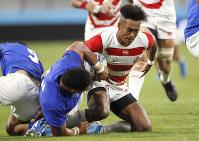 Japan's Kotaro Matsushima runs at that Samoan defense during the Rugby World Cup Pool A game at City of Toyota Stadium between Japan and Samoa in Tokyo City, Japan, Saturday, Oct. 5, 2019. (AP Photo/Shuji Kajiyama)