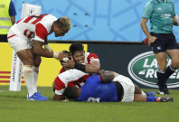 Japan's Timothy Lafaele is congratulated by teammates after scoring a try during the Rugby World Cup Pool A game at City of Toyota Stadium between Japan and Samoa in Tokyo City, Japan, Saturday, Oct. 5, 2019. (AP Photo/Shuji Kajiyama)