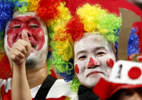 Japanese supporters gesture as they wait for the start of the Rugby World Cup Pool A game at City of Toyota Stadium between Japan and Samoa in Tokyo City, Japan, Saturday, Oct. 5, 2019. (AP Photo/Shuji Kajiyama)