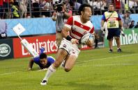 Japan's Kenki Fukuoka runs in to score a try during the Rugby World Cup Pool A game at City of Toyota Stadium between Japan and Samoa in Tokyo City, Japan, Saturday, Oct. 5, 2019. (AP Photo/Shuji Kajiyama)