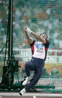 2004 Athens Olympics -- Japan's Koji Murofushi performs in the men's hammer throw. He finished the competition in second place but was later handed the gold medal as his competitor who finished in first place was disqualified on suspicion of doping.
