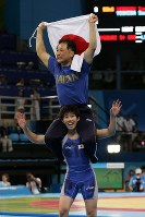 2004 Athens Olympics -- Japan's Saori Yoshida hoists her coach on her shoulders after winning the gold medal in the 55-kilogram division of the women's freestyle wrestling. She said after the competition,