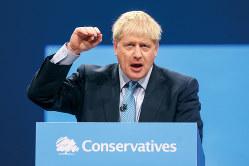 10月末に必ず離脱というが・・・・・・(保守党大会でのジョンソン首相)(Bloomberg)
