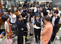 People form a line to collect refunds or change their tickets at JR Hakata Station in the western Japan city of Fukuoka on Oct. 11, 2019, as train operations on the Sanyo Shinkansen Line will be suspended on Oct. 12 in preparation for powerful Typhoon Hagibis. (Mainichi/Osamu Sukagawa)