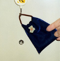 This file photo shows a way to prevent people from using a door peephole to see inside a home. (Mainichi)