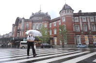A man walks in front of JR Tokyo Station in the capital's Chiyoda Ward on Oct. 12, 2019. The area is almost empty because most railway services were canceled in the Tokyo metropolitan area as Typhoon Hagibis is approaching central and eastern Japan. (Mainichi/Yuki Miyatake)