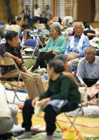 Seemingly worried residents are seen at an evacuation shelter in Tateyama, Chiba Prefecture, on Oct. 12, 2019, as Typhoon Hagibis approaches central and eastern Japan. (Mainichi/Koichiro Tezuka)