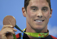In this Aug. 8, 2016, file photo, United States' Conor Dwyer shows off his bronze medal during the medal ceremony for the men's 200-meter freestyle final during the swimming competitions at the Summer Olympics in Rio de Janeiro, Brazil. (AP Photo/Michael Sohn)