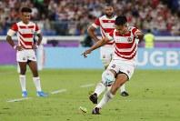 Japan's Yu Tamura kicks a penalty during the Rugby World Cup Pool A game at International Stadium between Japan and Scotland in Yokohama, Japan, Sunday, Oct. 13, 2019. (AP Photo/Eugene Hoshiko)