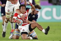 Japan's Yutaka Nagare, left, grabs the ball against Scotland's Jamie Ritchie during the Rugby World Cup Pool A game at International Stadium between Japan and Scotland in Yokohama, Japan, Sunday, Oct. 13, 2019. (AP Photo/Jae Hong)