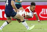 Japan's Kotaro Matsushima scores a try during the Rugby World Cup Pool A game at International Stadium between Japan and Scotland in Yokohama, Japan, Sunday, Oct. 13, 2019. (AP Photo/Eugene Hoshiko)