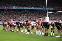 Players of the team Japan bow to the fans after the Rugby World Cup Pool A game at International Stadium against Scotland in Yokohama, Japan, Sunday, Oct. 13, 2019. Japan won 28-21. (AP Photo/Jae Hong)