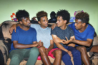 In this photo taken on Thursday, Oct. 10, 2019, from left, Eritrean under-20 soccer players Hermon Fessehaye Yohannes, Simon Asmelash Mekonen, Hanibal Girmay Tekle, and Mewael Tesfai Yosief talk together in a house where they are staying in Uganda. (AP Photo)