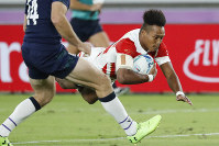 Japan's Kotaro Matsushima scores a try during the Rugby World Cup Pool A game at International Stadium between Japan and Scotland in Yokohama, Japan, on Oct. 13, 2019. (AP Photo/Eugene Hoshiko)