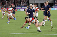 Japan's Kenki Fukuoka crosses for his team's third try during the Rugby World Cup Pool A game at International Stadium between Japan and Scotland in Yokohama, Japan, on Oct. 13, 2019. (AP Photo/Christophe Ena)