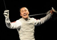 2008 Beijing Olympics -- Japan's Yuki Ota reacts after defeating Italy's Salvatore Sanzo, the silver medalist in the 2004 Athens event, in a semifinal in the individual foil in men's fencing. Ota lost the final but became the first Japanese medalist in the sport. (Mainichi/Akihiro Hirata)