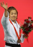 2008 Beijing Olympics -- Japan's Ryoko Tani waves to fans after taking the bronze medal in the 48-kilogram division in women's judo. She had given birth in 2005 and returned to competition after a break of two years. Tani announced before the event,