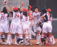 2008 Beijing Olympics -- The Japanese softball team celebrates after securing the gold medal to achieve a long-cherished goal. Ace Yukiko Ueno pitched in a semifinal, the bronze medal match and the final. It was previously announced that baseball and softball would be excluded from the Olympics in and after the 2012 London Games. Both sports will return to the 2020 Tokyo Games. (Mainichi/Akihiro Hirata)