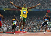 2008 Beijing Olympics -- Jamaica's Usain Bolt reacts after winning the gold medal in the men's 200 meters by setting a new world record of 19.30 seconds. He also won the gold in the 100 meters with a new world record of 9.69 seconds. (Mainichi/Naotsune Umemura)