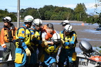 An elderly resident of the Kawagoe Kings Garden nursing home is rescued after being stranded due to flooding caused by Typhoon Hagibis, in Kawagoe, Saitama Prefecture, on Oct. 13, 2019. (Mainichi/Takashi Nakamura)