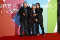 Actor Al Pacino, from right, director Martin Scorsese and actor Robert De Niro pose for photographers at the photocall of the film 'The Irishman' as part of the London Film Festival, in central London, on Oct. 13, 2019. (Photo by Joel C Ryan/Invision/AP)