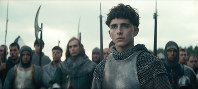 This image released by Netflix shows Timothee Chalamet, center, in a scene from 'The King.' (Netflix via AP)