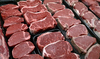 In this Jan. 18, 2010 file photo, steaks and other beef products are displayed for sale at a grocery store in McLean, Va. (AP Photo/J. Scott Applewhite)