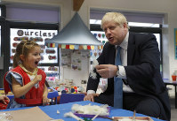 Britain's Prime Minister Boris Johnson gestures as he participates in an art class with Scarlet Fickling aged 4, in at St Mary's and All Saints Primary School in Beaconsfield, England, on Oct. 11, 2019. (AP Photo/Alastair Grant, Pool)