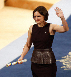 In this Friday Oct. 23, 2015 file photo, Esther Duflo of France waves after receiving the Princess of Asturias award for Social Sciences from Spain's King Felipe VI at a ceremony in Oviedo, northern Spain. (AP Photo/Jose Vicente, File)