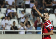 Russia's Denis Cheryshev celebrates after scoring his side's fifth goal during the Euro 2020 group I qualifying soccer match between Cyprus and Russia at GSP stadium in Nicosia, Cyprus, on Oct. 13, 2019. (AP Photo/Petros Karadjias)