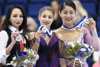 Russia's Elizaveta Tuktamysheva, left, Russia's Alena Kostornaia, center, and Japan's Yuhana Yokoi of Japan celebrate after the ladies free skating in the Finlandia Trophy Espoo international figure skating competition in Espoo, Finland on Oct. 13, 2019. (Heikki Saukkomaa/Lehtikuva via AP)