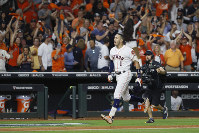 Houston Astros' Carlos Correa celebrates after his walk-off home run against the New York Yankees during the 11th inning in Game 2 of baseball's American League Championship Series on Oct. 13, 2019, in Houston. (AP Photo/Matt Slocum)