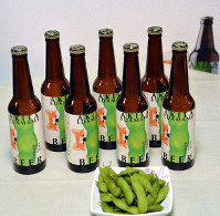 Bottles of Akita Edamame Beer are seen with a dish of edamame green soybeans in this photo taken in Odate, Akita Prefecture, on Oct. 11, 2019. (Mainichi/Hikoshi Tamura)