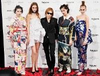 X Japan leader Yoshiki, center, and models showcasing his kimono fashion brand