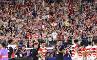Japan supporters cheer the Brave Blossoms at International Stadium Yokohama (Nissan Stadium) in Yokohama on Oct. 13, 2019, as the team beat Scotland to qualify for the Rugby World Cup quarterfinals. (Mainichi/Tatsuya Fujii)